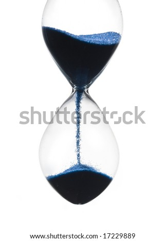 The End Of Time. Hourglass closeup shot (isolated - white background) - stock photo