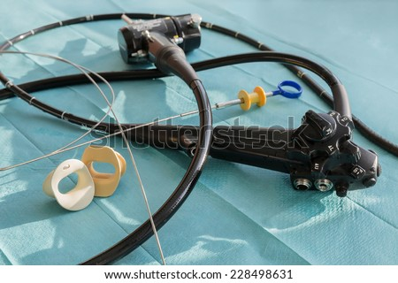 The endoscope, the mouthpiece and the biopsy forceps - stock photo