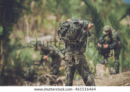 endurance test military training commando movement stock photo