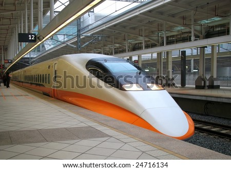 The engine of a modern express train inside the station - stock photo