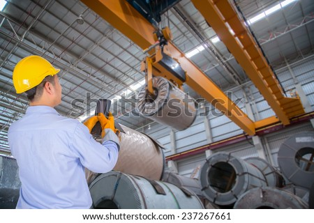 The engineer control the crane in the industrial - stock photo