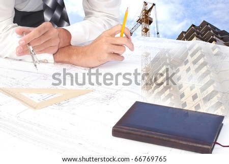 The engineer-the designer develops a construction plan of a many-storeyed apartment house - stock photo