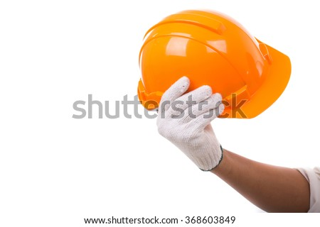 The Engineers hold helmet Safety orange isolated white background