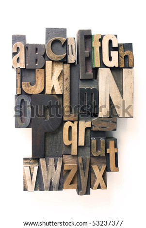 the english alphabet in wooden letterpress printing blocks - stock photo
