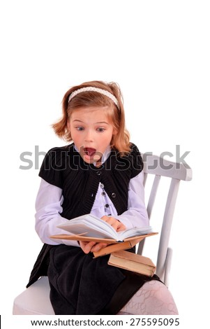 The enthusiastic schoolgirl reading open book on a white background - stock photo