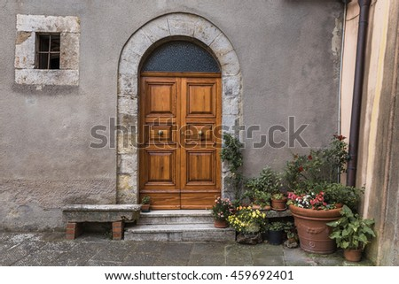 The entrance door in an old Italian house.
