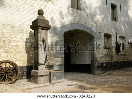 The entrance of an old castle. Flanders, Belgium. - stock photo