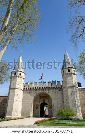 The entrance of Topkapi Palace in Istanbul Turkey. The Arabic text on the gate says: There is no God but Allah, and Mohammad is Allah's prophet. Also Ottoman Sultan's Tugra (signature). - stock photo