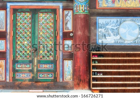 The entrance to Bongeunsa Temple in Seoul, South Korea. To the right is a rack for shoes. - stock photo