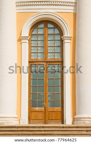 The entrance to the building with columns - stock photo