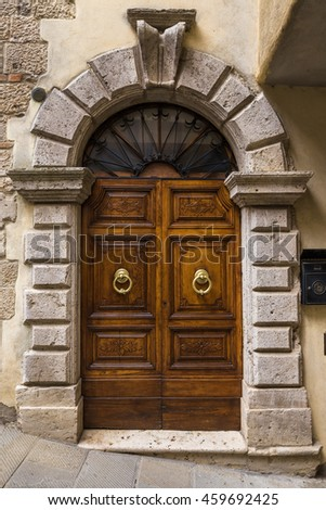 The entrance wooden door in an old Italian house.