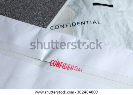 The envelope with red ink stamped with the word confidential represent the letter and symbol concept related idea.