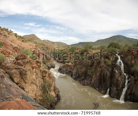 The Epupa Falls lie on the Kunene River, on the border of Angola and Namibia - stock photo
