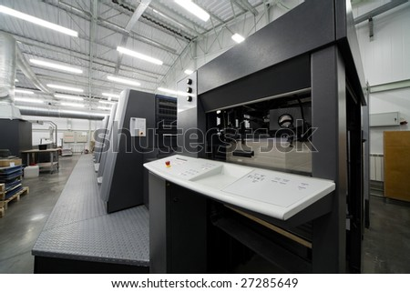 The equipment for a press in a modern printing house - stock photo