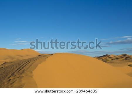 the erg chebbi sand dunes in merzouga, morocco - stock photo