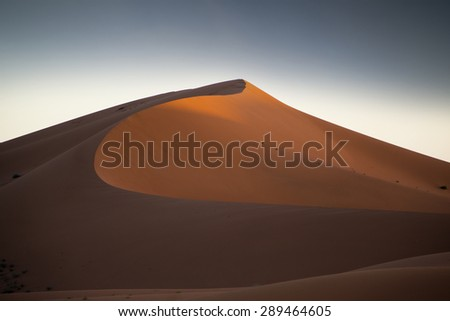 the erg chigaga sand dunes in morocco - stock photo