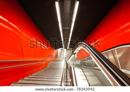 The escalator in motion. - stock photo