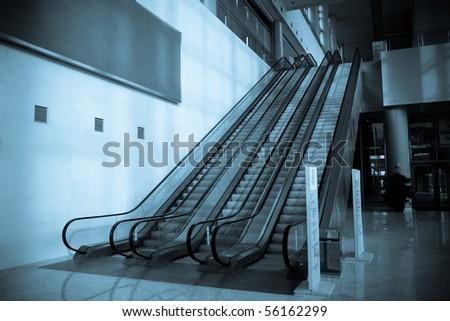 The escalator in shopping center - stock photo