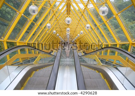The escalator of pedestrian bridge - stock photo