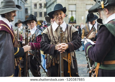 The Esclade festival in the old town of Geneva. Men wearing historical costumes gather on the streets. December, 2013