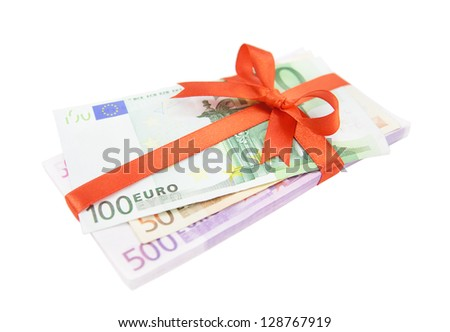 The euro money pile bound with a satin red ribbon and bow isolated on white background - stock photo