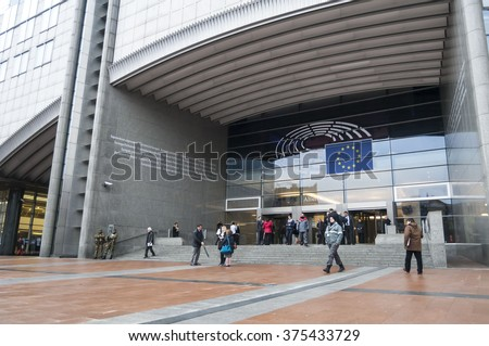 The European Parliament main building in Brussels, protected by guards because of terror attacks threat. Stock photo. Bruxelles, Belgium, January 2016. - stock photo