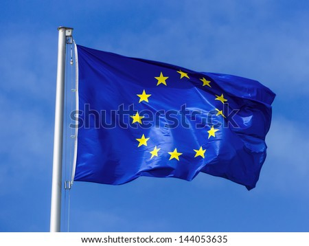 the european union flag blowing in the wind. eu flag - stock photo