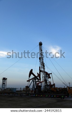 The evening of oilfield derrick silhouette, it is very beautiful