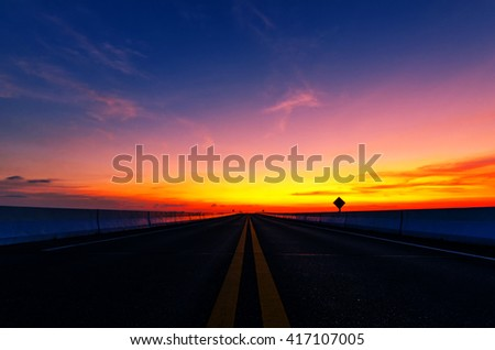 The evening sun on the road in Thailand. - stock photo