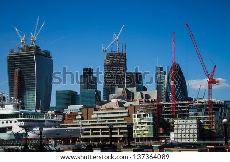 The ever-changing cityscape of the City of London seen from the south bank of the Thames near Tower Bridge. May 2013. - stock photo