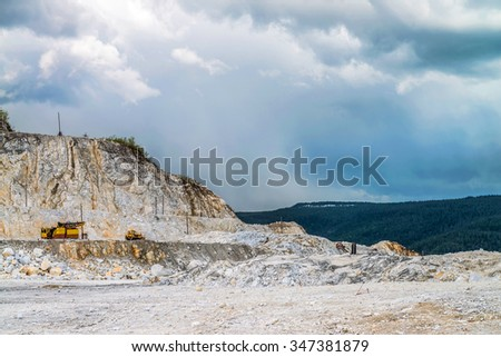 The excavator has been working on the extraction of gravel - stock photo