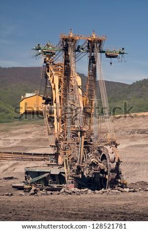 the excavator in coal opencast - stock photo