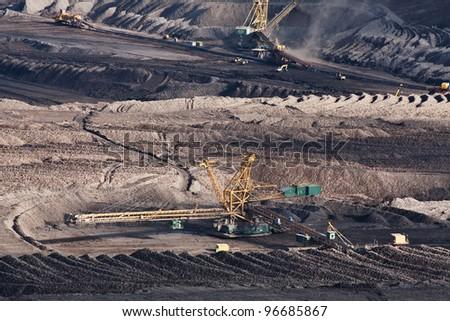 the excavator in coal opencast near Most - Czech Republic - stock photo