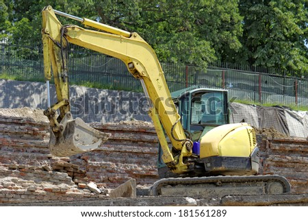 the excavator working on a construction site - stock photo