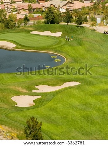 The exclusive golf resort and the players in action - stock photo