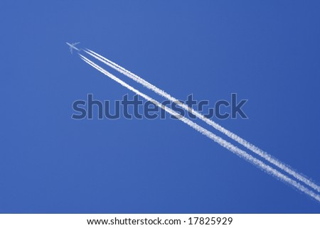 The exhaust trail behind a large aircraft high in the atmosphere