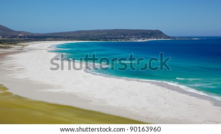 The expanse of Long Beach, with Kommetjie in the background, Cape Peninsula, Cape Town, South Africa. - stock photo