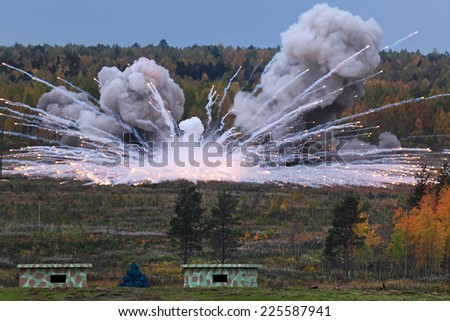 The explosion of the ammunition at a military training ground - stock photo