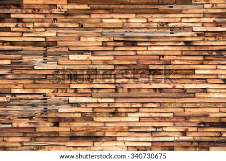 The exposed wooden exterior or a grain elevator revealed this beautiful patchwork of old wood forming a beautiful parquet wood pattern. - stock photo