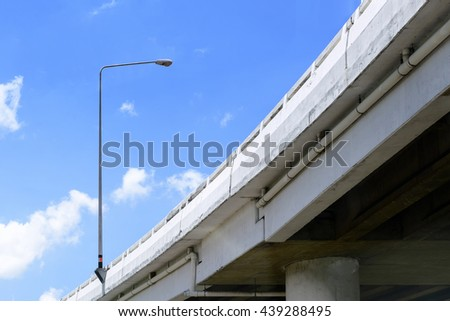 The express way building with the electricity pole in the blue sky day. - stock photo