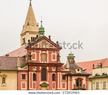 the exterior facade of Saint George Basilica: red and yellow colours in a gloomy and rainy day - stock photo