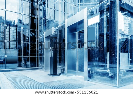 The exterior is a glass curtain wall elevator, blue tone chart.