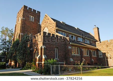 The exterior of a historic catholic church under the blue sky in Edmonton, Alberta, Canada - stock photo