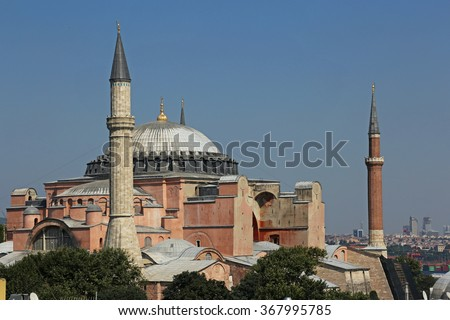 The exterior of Hagia Sophia shot from the rooftops of nearby buildings, located in Istanbul, Turkey.  It was constructed in 537 by Byzantine Emperor Justinian I. - stock photo