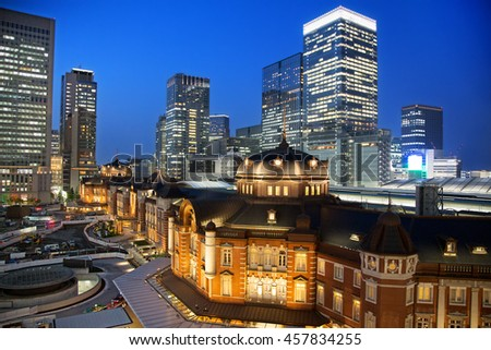The exterior of the famous Tokyo Train Station at night, which has stood in the Marunouchi district for over 100 years. All identifiable logos removed.  - stock photo