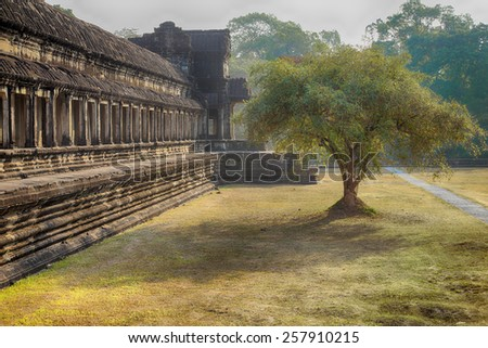 The exterior of the south wall of Angkor wat, part of a temple complex in western Cambodia - stock photo
