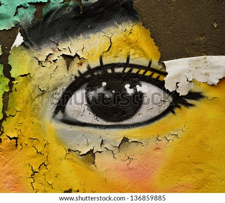 The eye, Colorful texture on the rough and cracked wall as great artistic - stock photo