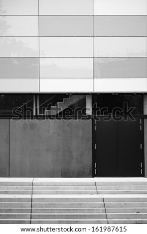 The facade of a modern building with an exterior and interior stairs / Building facade               - stock photo