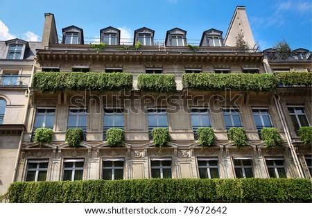 The facade of apartment building in Paris - stock photo