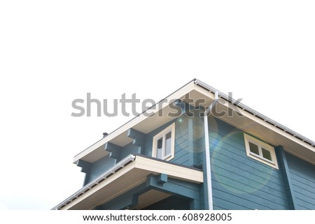 The Facade of modern wooden house with Windows.